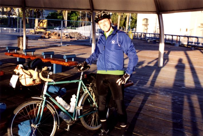 ryan_and_bike_at_ferry_terminal.jpg